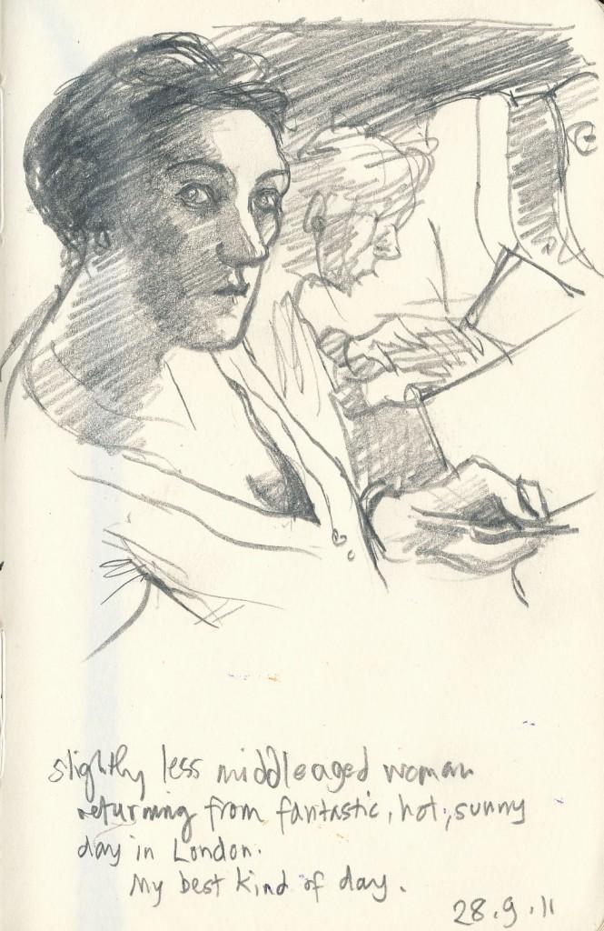 28.9.11 self portrait drawing on train